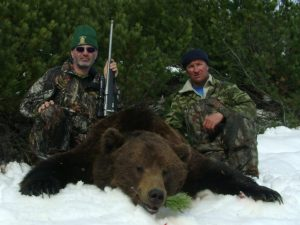 two hunters and brown bear trophy, taken in Magadan