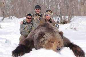 Hunter with outfitter and the brown bear trophy