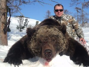 Hunter and his brown bear trophy, guided hunt with Kulu Safaris