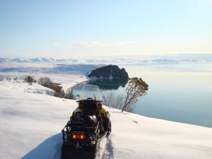 Snowmobiling in Russia while hunting with Kulu Safaris