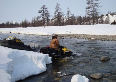 Passing the river by snowmobile in Magadan, Russia