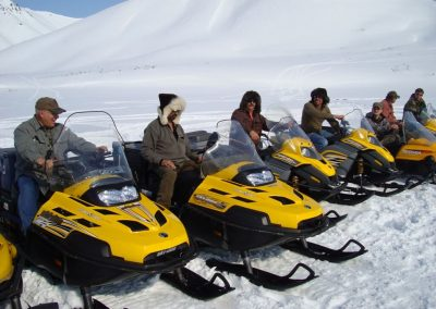 Hunters on snowmobiles