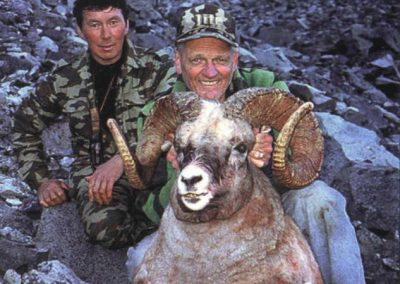 Snow sheep hunters with their big trophy