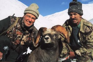 Two hunters with their snow sheep trophy in the mountains, Kulu Safaris