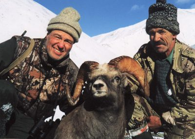 Hunters with their trophy in the mountains, Magadan, Russia with Kulu Safaris