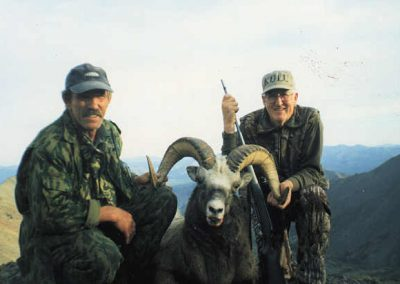 Hunters high in the mountains with their trophy, Magadan, Russia with Kulu Safaris